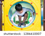 asian boy playing on playground | Shutterstock . vector #1286610007