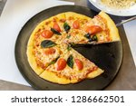 pizza on the black plate ... | Shutterstock . vector #1286662501