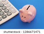 piggy bank and calculator on... | Shutterstock . vector #1286671471