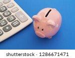 piggy bank and calculator on... | Shutterstock . vector #1286671471