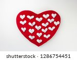small white paper hearts on a... | Shutterstock . vector #1286754451