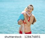 portrait of mother and baby... | Shutterstock . vector #128676851