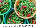 closeup green and red chilli in ... | Shutterstock . vector #1286809024