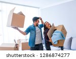 new home. funny young couple...   Shutterstock . vector #1286874277