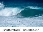 perfectly shaped surfing wave | Shutterstock . vector #1286885614