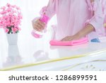 asian woman cleaning the floor... | Shutterstock . vector #1286899591