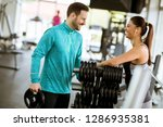 young woman exercise in a gym... | Shutterstock . vector #1286935381