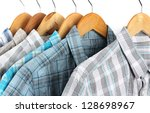 shirts with ties on wooden... | Shutterstock . vector #128698967