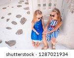 two girls in blue dresses...   Shutterstock . vector #1287021934