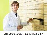 smiling pharmacist posing in...   Shutterstock . vector #1287029587