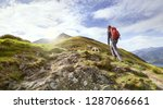 A Hiker Walking Up A Mountain...