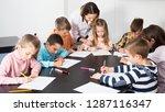 teacher and elementary age... | Shutterstock . vector #1287116347