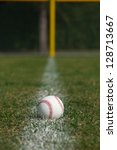 baseball on the outfield foul... | Shutterstock . vector #128713667