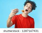 a man eats rolls with... | Shutterstock . vector #1287167431