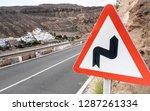a triangular road warning sign...   Shutterstock . vector #1287261334