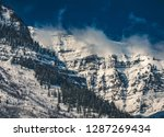 clouds move over the dramatic... | Shutterstock . vector #1287269434