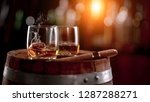 whiskey drinks with flying ice... | Shutterstock . vector #1287288271