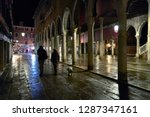 Stock photo people walking with the dog in venice fish market at night 1287347161