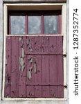 old wooden expired access door... | Shutterstock . vector #1287352774