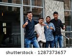 group of four indian mans  wear ... | Shutterstock . vector #1287373657