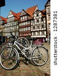 bicycles in rack in the town... | Shutterstock . vector #1287381