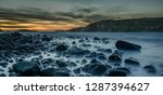 black rocks lying calmly in the ...   Shutterstock . vector #1287394627