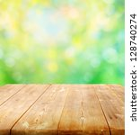 summer background with wooden... | Shutterstock . vector #128740274