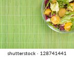 Vegetable salad on green background top view - stock photo