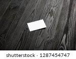 business card blank on wooden... | Shutterstock . vector #1287454747