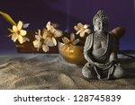 stone sitting buddha flowers...   Shutterstock . vector #128745839