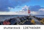 Lighthouse On The Beach Of...
