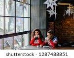 couple walking through winter... | Shutterstock . vector #1287488851