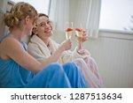women drinking champagne in... | Shutterstock . vector #1287513634
