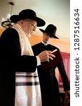 side view of an elderly priest... | Shutterstock . vector #1287516634