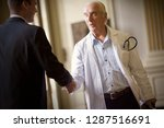 view of a doctor shaking hands... | Shutterstock . vector #1287516691