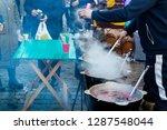 hot drinks in a pot over an... | Shutterstock . vector #1287548044