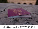 passport is on stone surface | Shutterstock . vector #1287553531