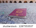 passport is on stone surface | Shutterstock . vector #1287553537