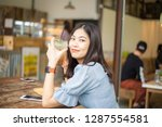 business asian women with ice... | Shutterstock . vector #1287554581