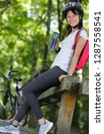 woman drinking after cycling on ... | Shutterstock . vector #1287558541