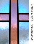cross on glass window | Shutterstock . vector #1287569074