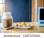 coffee in jar with cookies on... | Shutterstock . vector #1287570331