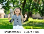 sweet little girl having fun in ... | Shutterstock . vector #128757401