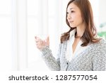 young attractive asian woman... | Shutterstock . vector #1287577054