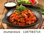 spicy chicken ribs on a plate | Shutterstock . vector #1287583714