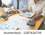 business advisor analyzing... | Shutterstock . vector #1287626734