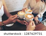 group of friends cheers with... | Shutterstock . vector #1287629731