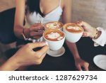 group of friends cheers with... | Shutterstock . vector #1287629734