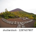 a hiking path leading up mount... | Shutterstock . vector #1287637807