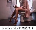 using toilet. woman in bath... | Shutterstock . vector #1287692914